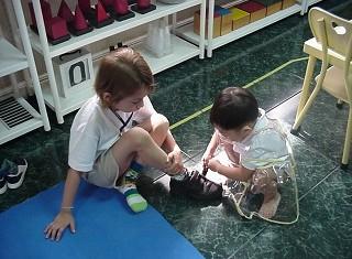Boy tying shoes