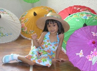 Girl with umbrellas
